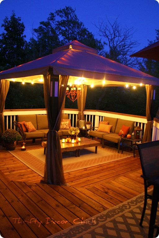 outside deck- outdoor carpet, lights in canopy, candles on table :)