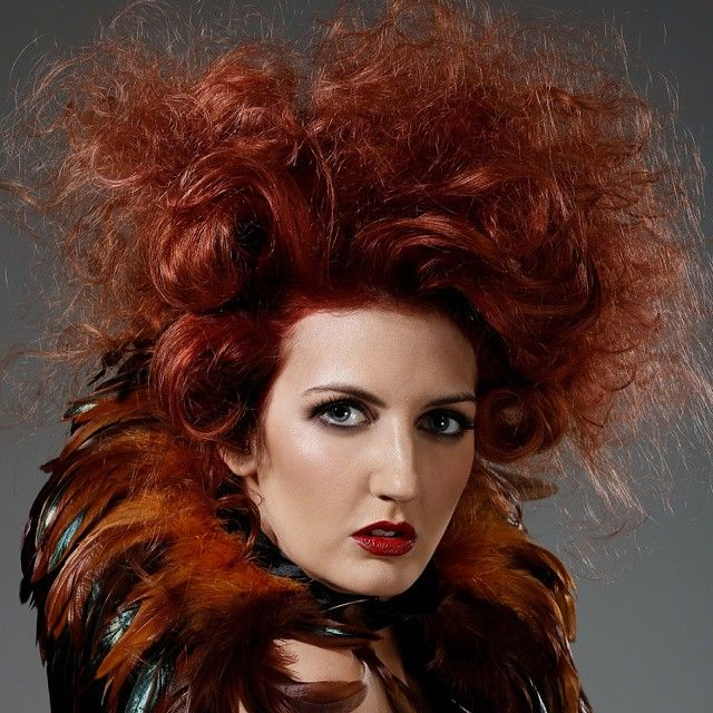 Work by Nakia Stevens #urbannative #wella #trendvision #trendvision2014 #soft #beautiful #hair #hairstyle #competition #photoshoot #makeup #texture #bighair #red #feathers #iwantthathair