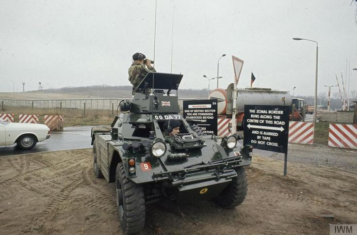 Soldiers of 1st Battalion, 22nd Cheshire Regiment observe activity at an East German checkpoint from their Ferret scout car during a patrol of the Berlin Wall, c 1971.