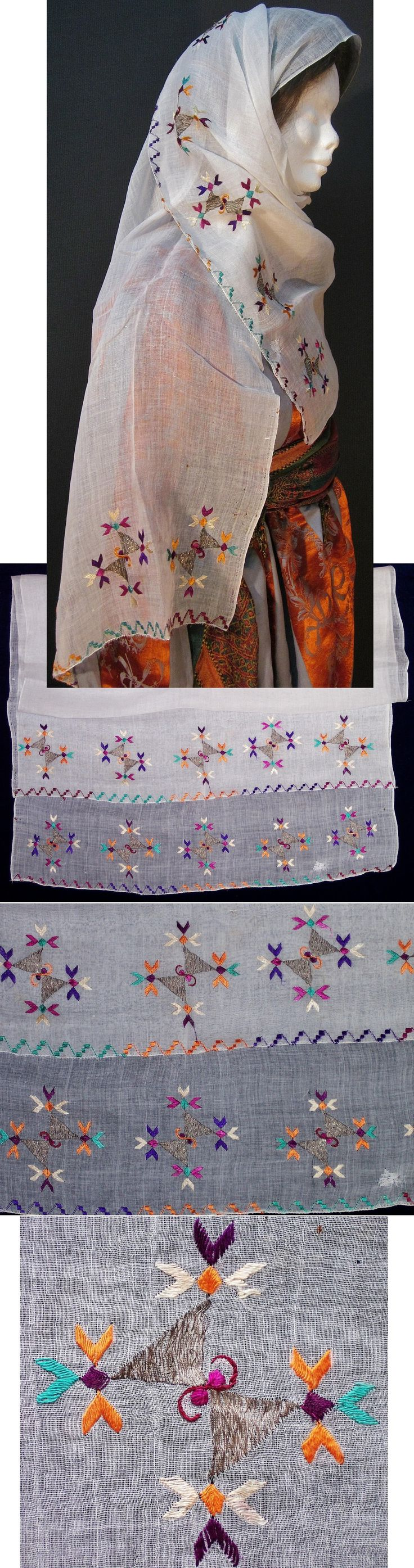 Large embroidered 'yazma' (woman's headscarf) from Central-Anatolia. First quarter of the 20th century. Adorned with two-sided embroidery (identical on both sides of the fabric) in multicoloured cotton, silk and metal thread on linen. A composed geometrical motif is repeated 2 x 5 times (Inv.nr. yaz078 - Kavak Costume Collection-Antwerpen/Belgium).