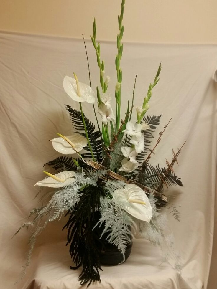 Black beards ghost challenge.  All black and white. Glads, anthirium, ameranthus, flat fern, and plumosa fern