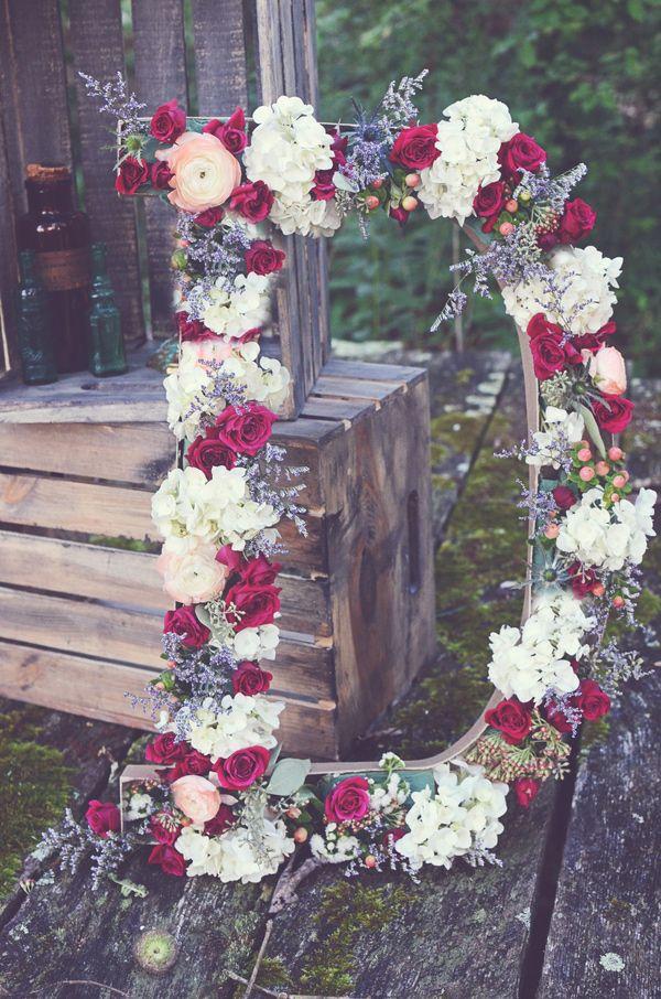 giant floral initials - photo by Amy Wallen - http://ruffledblog.com/woodland-bohemian-wedding-ideas/