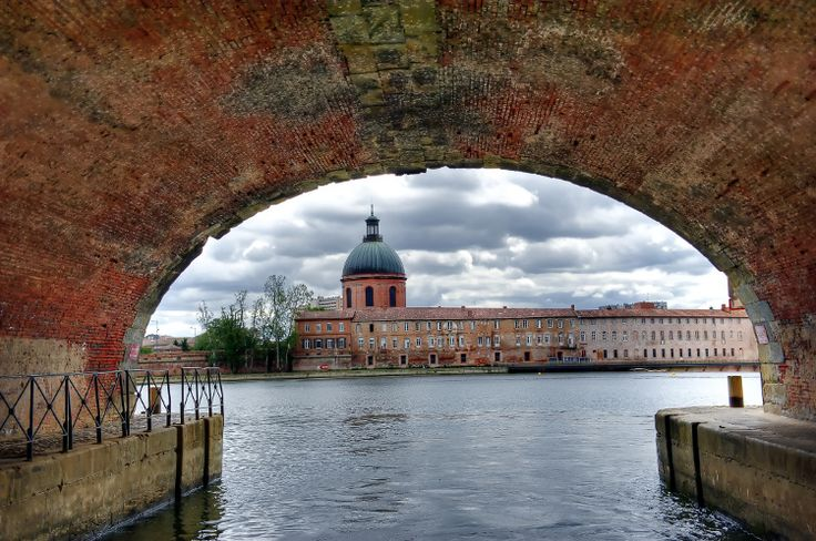 """Sail the Canal du Midi. From Toulouse, Venture into the streets of the """"Pink City"""". The Basilica of Saint-Sernin through the famous Place du Capitole, Toulouse mixing colors and ages. Discover the pearl of the south of France. © Kevin Puget - Fotolia.com"""