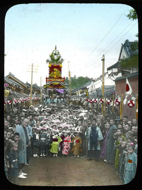 Boys dressed for drawing an ornamental car on a festival day  Enami Studio Lantern Slide No : 485.  About 1920's, Japan