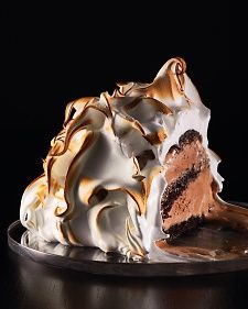 Baked Alaska - Would you be a fool to place ice cream in a 500-degree oven? Not as long as it's bundled up in a thick layer of insulating meringue. The outside caramelizes, turning warm and crisp like a toasted marshmallow; the inside (chocolate cake layered with chocolate ice cream) remains brr-illiantly chilly. These mini meringue-coated chocolate ice-cream-and-cake concoctions are stunning desserts for a crowd.