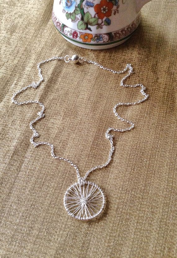 This long contemporary circle necklace is a unique silver round pendant that would be an elegant bridesmaid gift for your attendants on your