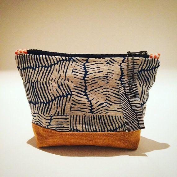 This purse/pouch is perfect for a cosmetics or to carry your phone, wallet and keys... or pencil case for the artistically inclined! The design was originally a metal plate etching representing ancient earth patterns. Screen printed in my studio in Byron Bay and hand sewn by me using quality YKK zip and water resistant interfacing. It is fully washable and measures 22 cm (9in) x 19cm (7in).