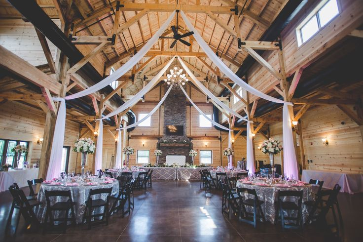 This wedding venue is gorgeous! I love how they used drapes to sort of frame the reception area. The pink color of them really goes well with the wood used in the building. My fiance would love a venue like this for our wedding. Maybe I'll show her this picture and see if helps in our hunt for the perfect venue.