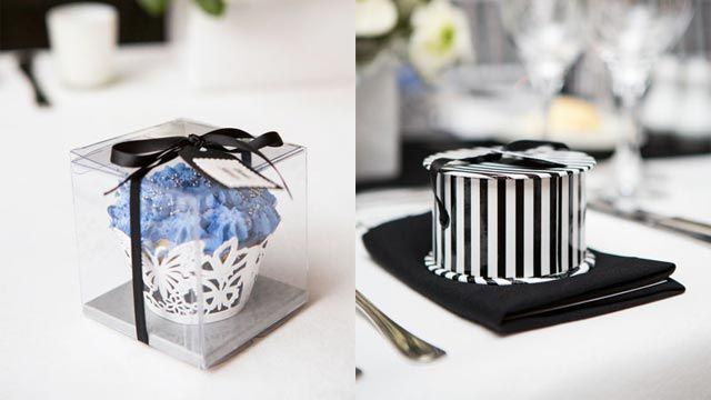 Pretty cupcakes in cellophane boxes served as place cards, and each guest received a striped box of delicious Belle Fleur chocolates as bomboniere. Image by Inlighten Photography.