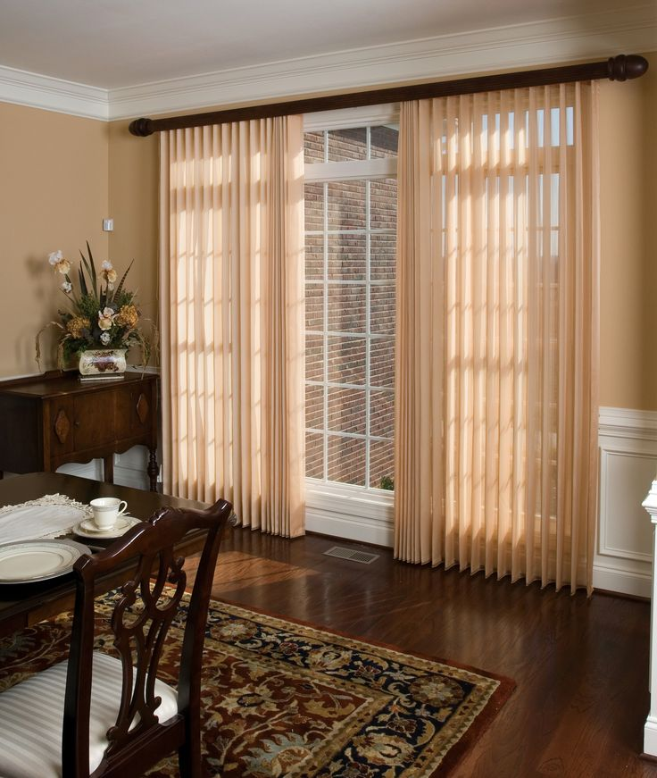Sheer ADO batiste fabric engulfs a set of vertical blinds. Fabric color is called Blonde.