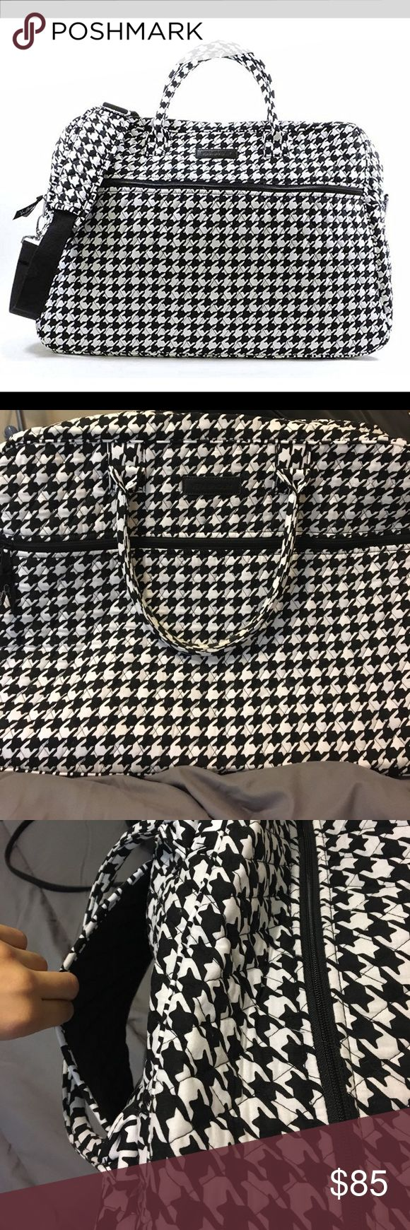 Vera Bradley Grand Traveler- Midnight Houndstooth Only used once, in perfect condition! TSA approved carry on bag. Has plenty of room for various items, with 4 large pockets on the inside of the bag, one zip up pocket on the front of the bag. The back of the bag has an opening which allows you to slide the bag over a rolling suitcase. Also features a detachable strap to carry over the shoulder. 85$ OBO Vera Bradley Bags Travel Bags