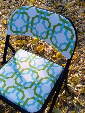 Recovered folding chair. Do this to a card table and chairs set in laminated cotton