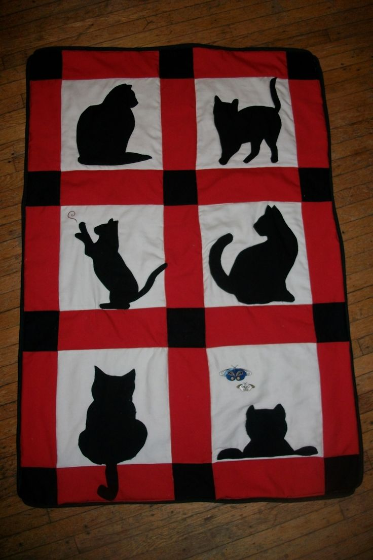 Cat quilt for Sarah. I went on line found shadow cats. Copy, pasted and blew them up to make a patteren. Used my Embroidery machine for the butterfly and yarn ball that the cat is reaching for.