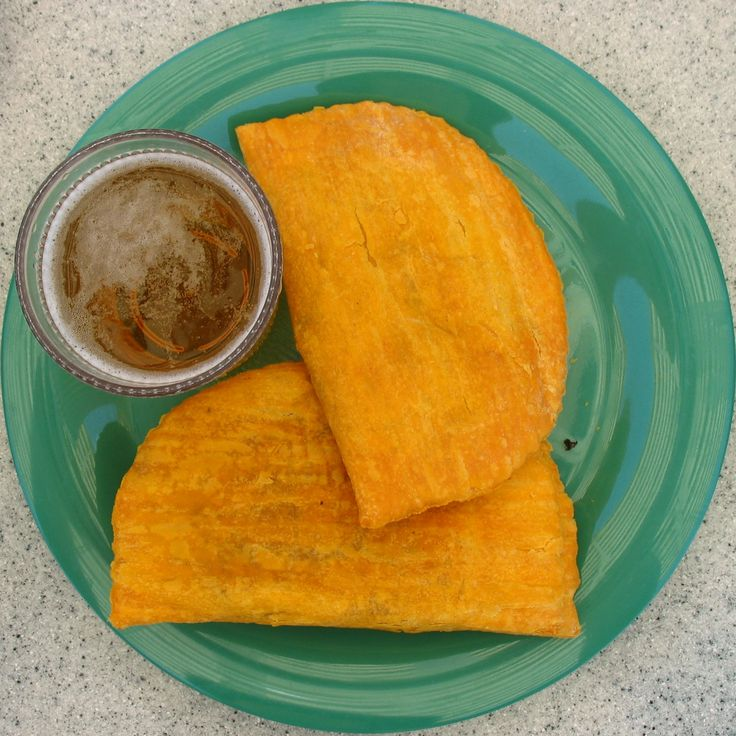 Jamaican Patty and Red Stripe beer   - You can't visit Jamaica and NOT have these!