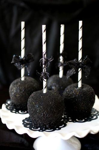 Caramel apples Decorative lollipop sticks Black sanding sugar Black jimmies Black plastic spiders (for decoration) Black ribbon...