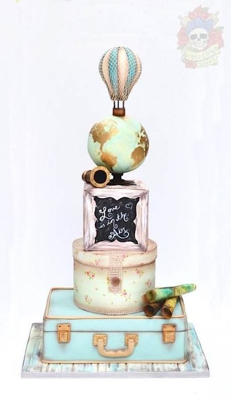 A wedding masterpiece of vintage sweetness, pastel romance, and hot air balloony, globe-y goodness