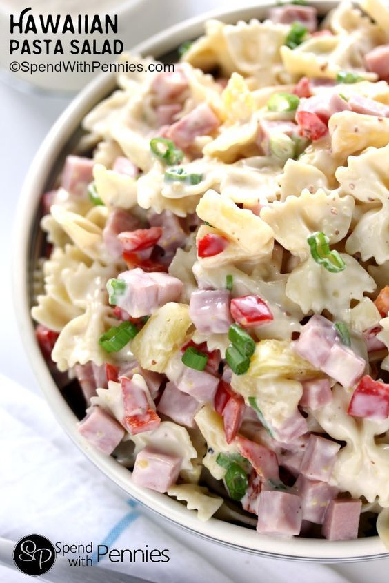 This is literally one of the most delicious cold pasta salad recipes!  Pasta combined with ham and sweet pineapple and tossed with a delicious homemade dressing...it's the perfect combination!!