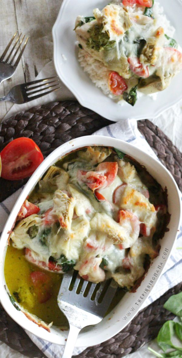You have to try this AMAZING dinner recipe!  Easy Pesto Spinach Artichoke Chicken Bake only takes about 10 minutes to put together and is the BEST dinner!