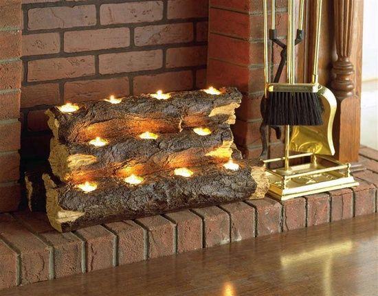 unbenutzter kamin im wohnzimmer holzklotz teelichter ziegel