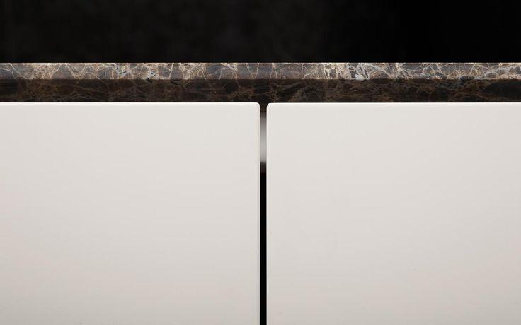 Atelier kitchen with marble Emperador worktop by Minotti