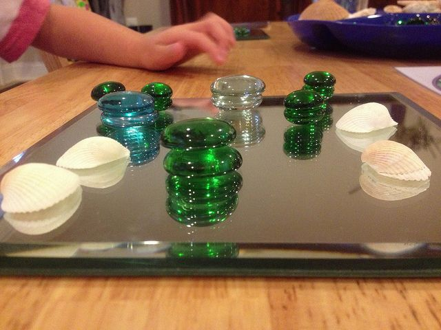 loose parts and mirrors; making towers; symmetry; gems; learning through play; play matters