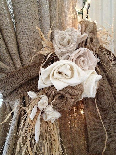 Burlap can be so Beautiful! – lovely roses… maybe tuck in some rolled linen – a vintage hankie here & there ~ pretty tiebacks!