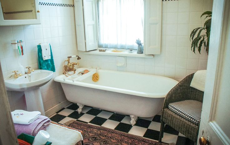 A view of this Paarl property's bathroom with checkered flooring.