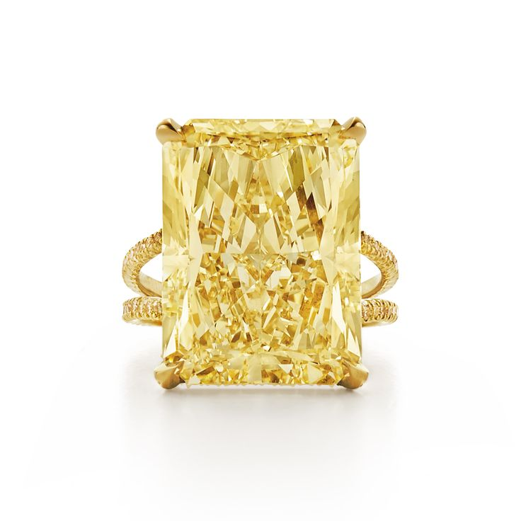 Radiant fancy yellow diamond ring with split yellow diamond band. Set in 18k yellow gold.