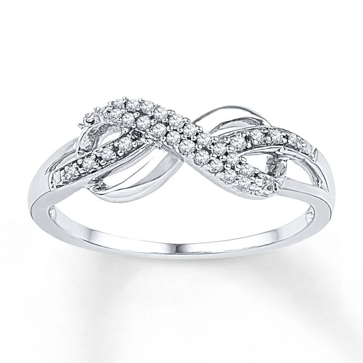 Two rows of beautiful round diamonds adorn an infinity symbol in this ring for her. Crafted in sterling silver, the ring has a total diamond weight of 1/10 carat. Diamond Total Carat Weight may range from .085 - .11 carats.