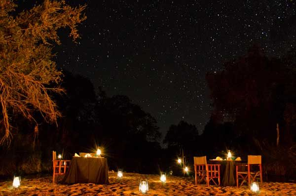 Sabi Sabi Private Game Reserve, South Africa - candle-lit dinner on a sandbank in the Msuthlu River