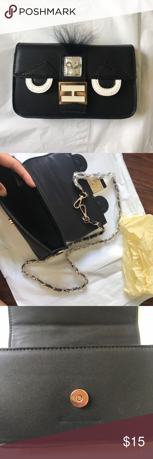 Melie Bianco Black Monster Crossbody Purse New never used! Super cute! Looks like a designer brand monster items. Chain crossbody that you can add on! Comes with dustbag Melie Bianco Bags Crossbody Bags