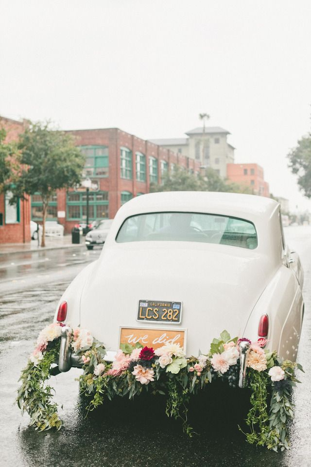Vintage white getaway car with garland | Onelove Photography | see more on: http://burnettsboards.com/2014/03/fig-gold-wedding-coolest-bar/