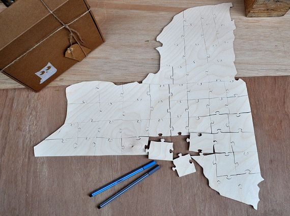 The shape of New York for wedding guest book 100% handmade cutting. One other idea... print the first letter of your name and your wedding day or