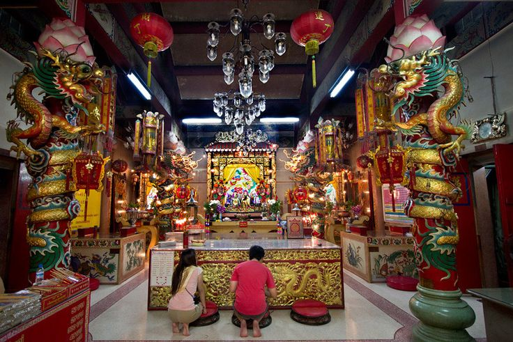 Buddhists worship at the ornate Mai Pung Tao Gong Chinese Temple in Chiang Mai, Thailand