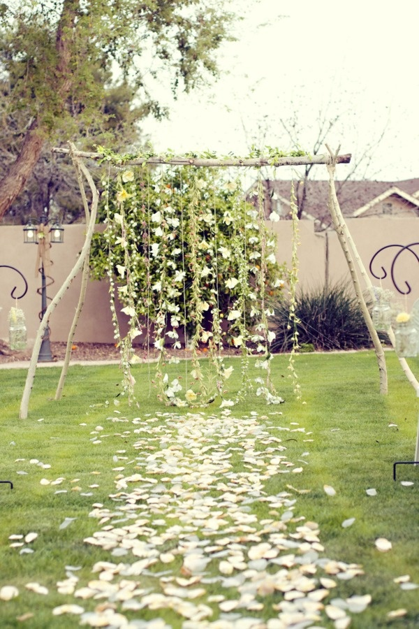 Another gorgeous backdrop, perfect idea for an outdoor spring ceremony. Choose either light or bright colored floral chains as well as greenery to attract your guests, and to make your ceremony even more special.