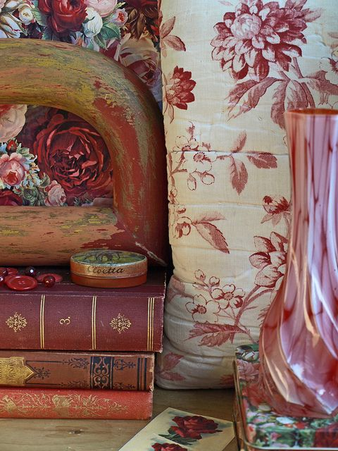 Beautiful vignette of books and vase for Red French Sitting Room