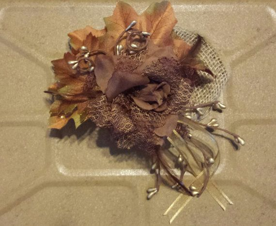 Unique rustic fall wedding hairpiece. Brown with burlap and gold accents. Measures 6 by 7 and is mounted on a 3.5 by 2 plastic haircomb.