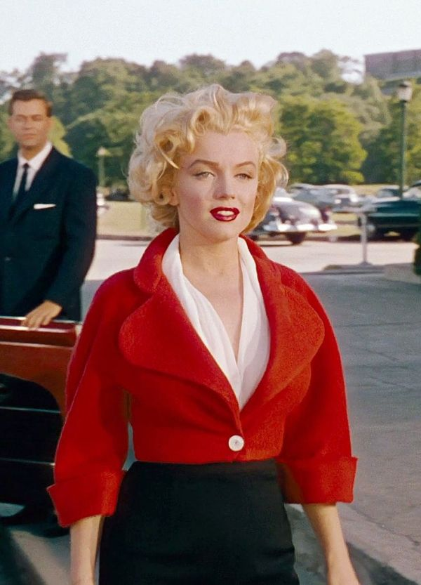 """Marilyn Monroe as Rose Loomis, smiles after hearing the signal from her lover, in """"Niagara"""" 1953"""