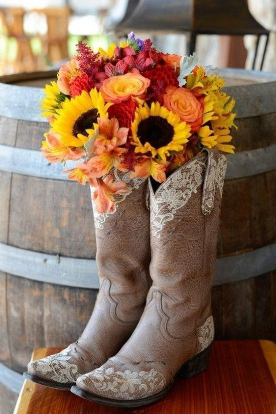 The charm that comes along with farm weddings relies on simple details, so save your time and money on elaborate decorations with this DIY wedding idea. How neat would this sunflower arrangement in cowboy boots look on your welcome table?