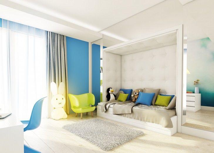 Projekt wnętrza pokoju dziewczynki w niebiesko zielonych barwach. Na drzwiach szafy znajduje się lustro, które powiększa przestrzeń.