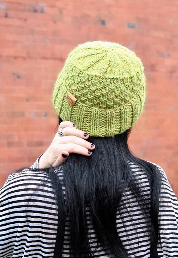 Unique one off handknitted fisherman hat in Green. Knit in a textured moss stitch for extra snugness! Each piece is knit by hand in our North Wales studio so every hat is unique. Finished with a Junkbox Ultraleather tag. Wool/Acrylic blend. Unisex style. One size fits all. THE Winter
