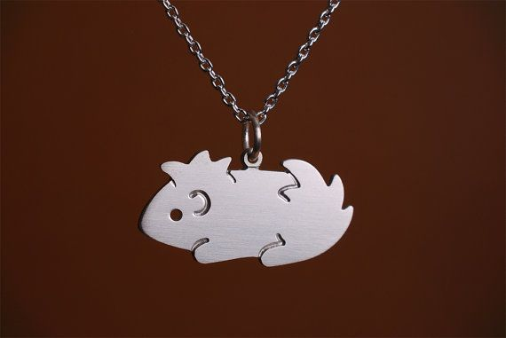 Guinea Pig Necklace - Guinea pigs tend to defy being artistically simplified, but I love this!