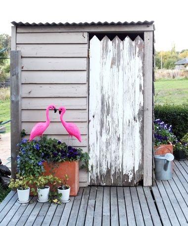 Cute pink flamingo decor idea for a garden planter. #flamingos #gardens