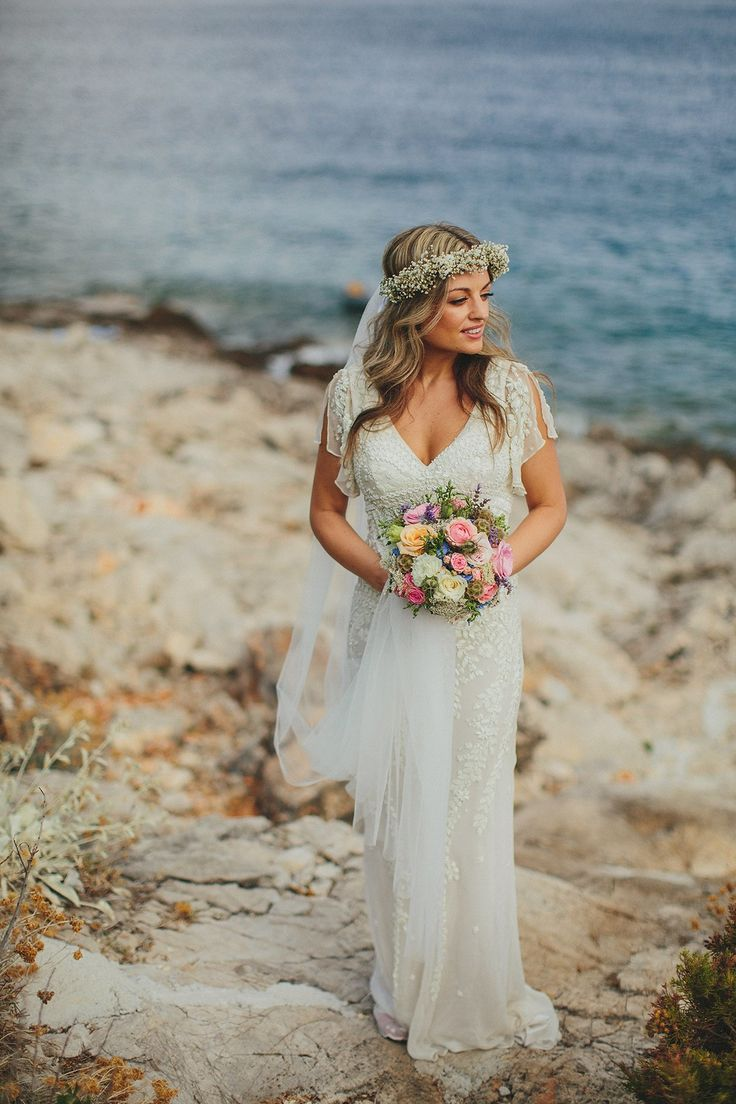 Bride Tamar wears an embellished Eliza Jane Howell gown and crown of gypsophila for her Croatian Island wedding. Photography by Petar Jurica.