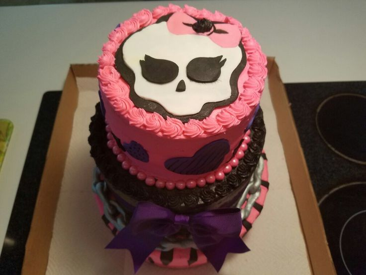3 tier monster high birthday cake. Vanilla cake with buttercream, monster high decorations!!!!
