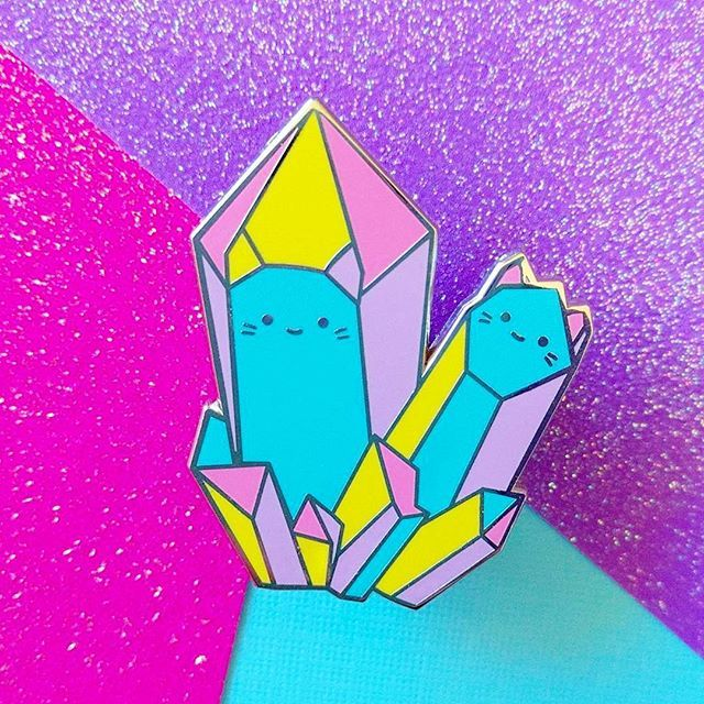 Still have a few of these available. 💎✨ They may or may not give you magical crystal cat powers. 🐈🔮💞 (Thanks to @meowmeowmilkshoppe for this photo! 🐱) #pins #pingame. . . . . #enamelpins #lapelpin #lapelpins #rainbow #crystals #magical #cats #catperson #artistsofig #design #pinsofig #pinaddict #pastelaesthetic #pinstagram #prettypastels #catlove #pastel #kawaii