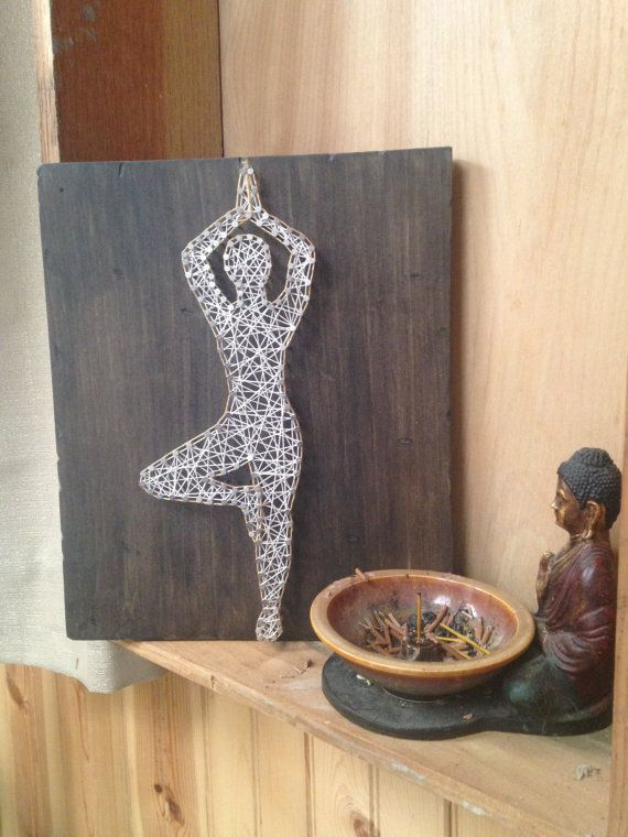This Yoga string art is hand strung with string on weathered wooden rough cut…