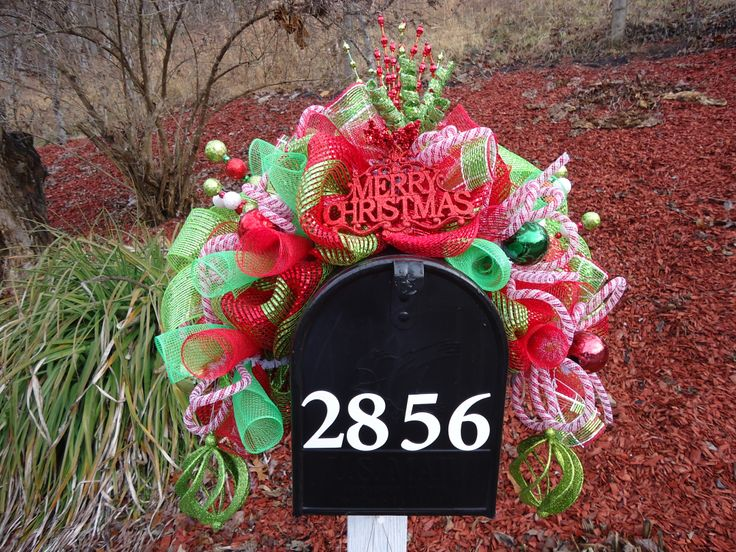 Christmas mailbox swag. Most wreaths can be customed order, check out my page on Facebook Cj's deco mesh.