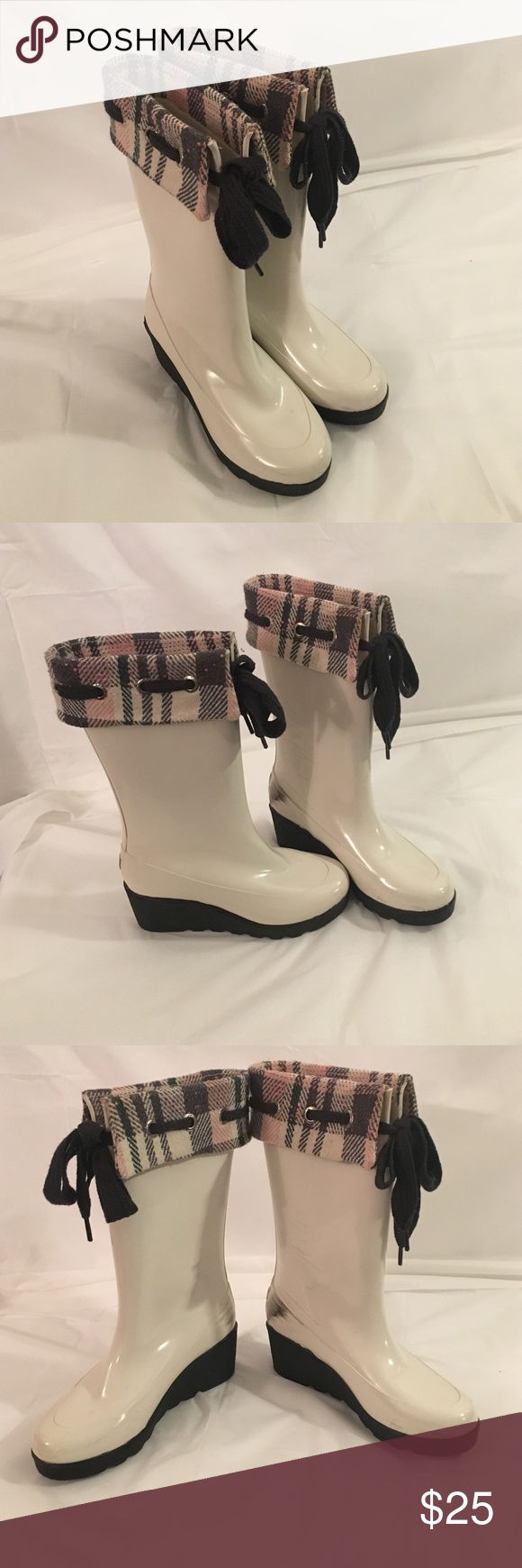 Sperry white rain boots Rain boot with black wedge. Black spots from shoes rubbing. Sperry Top-Sider Shoes Wedges