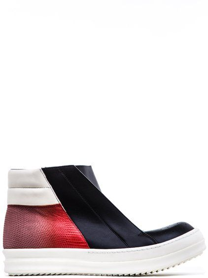 RICK OWENS SS17 WALRUS ISLAND DUNK PULL-ON SHOES ARE LACELESS WITH TWO LARGE EYELET DETAILS AT THE TOP, HOLE DETAILS IN FRONT, DEGRADE CORALLO RED LIZARD LEATHER DETAILS AT THE BACK AND WHITE RUBBER SHARK-TOOTH SOLES.    * COLOR: BLACK, RED AND WHITE.  * SIDE ZIPPER FASTENING.  * BODY: 100% CALF LEATHER.  * DETAIL: 100% LIZARD LEATHER.  * LINING: 100% CALF LEATHER.  * INSOLE: 100% CALF LEATHER.  * SOLE: 100% RUBBER.